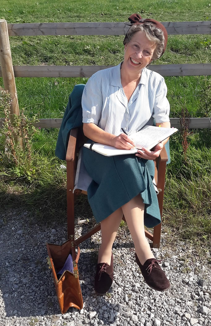 Julie in her cameo-role costume after filming for six hours in September 2014. And yes, it is a grey curly wig.
