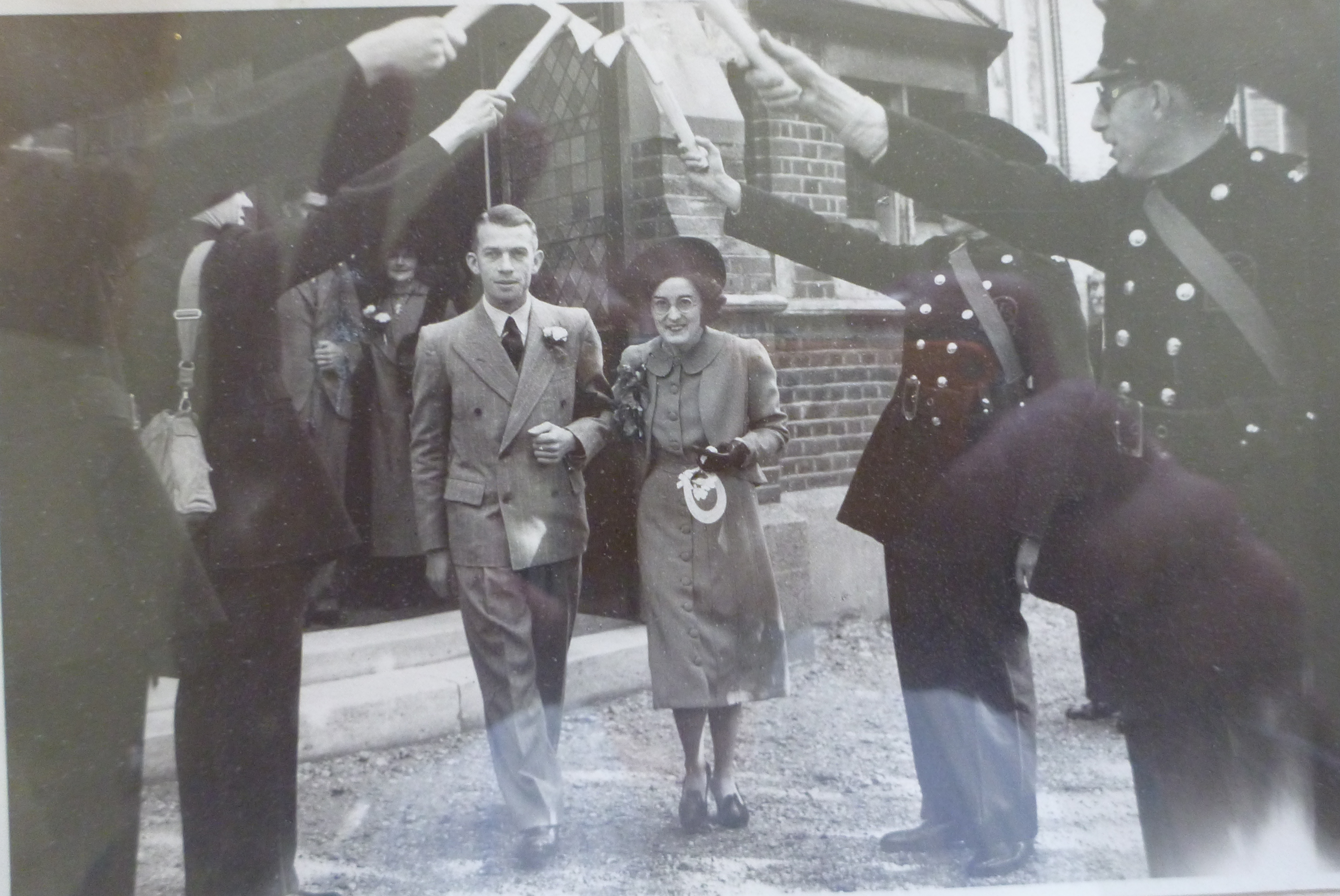 Frank and Gladys Mason with a guard of honour from the Fire Brigade